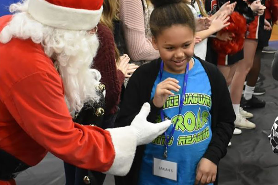 Community Involvement - Happy Girl Meeting Santa Claus During Sleep Dreams Event