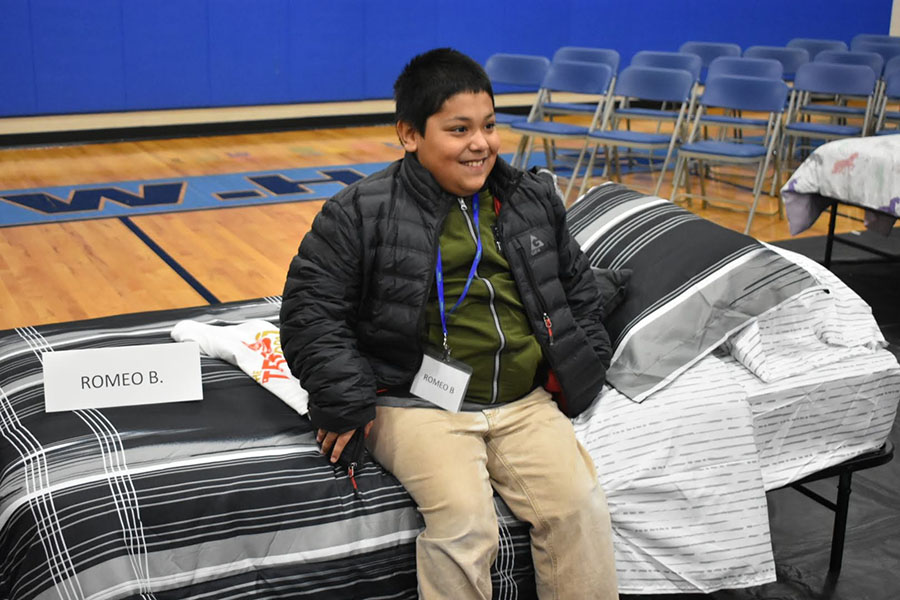 Community Involvement - View of Happy Boy Trying Out His Bed During Sleep Dreams Event